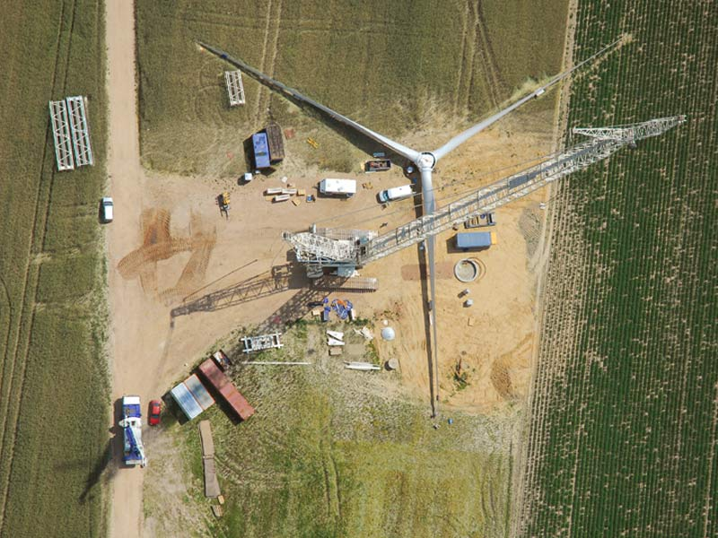 The aerial photograph shows the construction of the one hundredth wind power plant in Danna